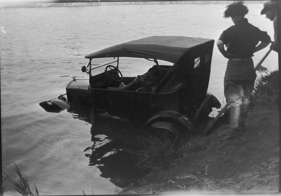 Two ancestors pulling a Model T out of a river. Not sure who, where, or when. Possibly Laura and Gil.