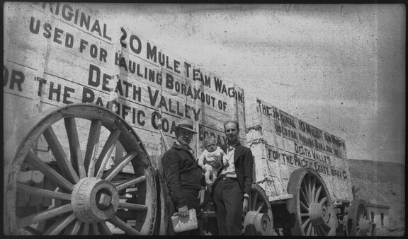 George and Gil. Writing on the train reads,