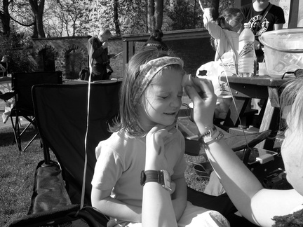 Grace having her face painted