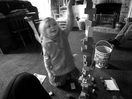 Grace playing with a tower of wooden blocks