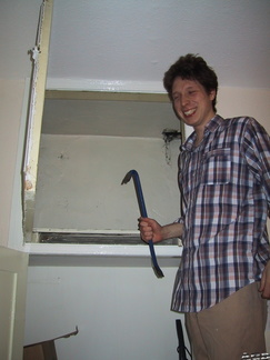 Rob opening the cupboard