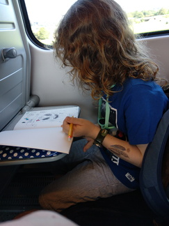 Isaac sketching on the train.jpg