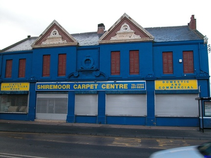 Old Co-Op in Shiremoor, in a delightful shade of blue. The road to the right is 'Co-Operative Terrace'.